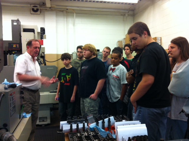 Students on Rodon manufacturing plant tour.